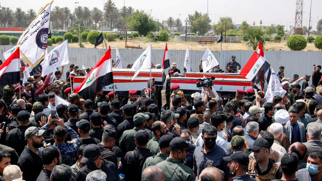 Iraqi fighters mourn comrades killed in US air strikes