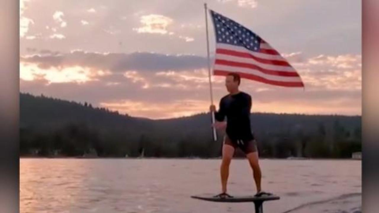 Zuckerberg posts flag-waving video on electric surfboard