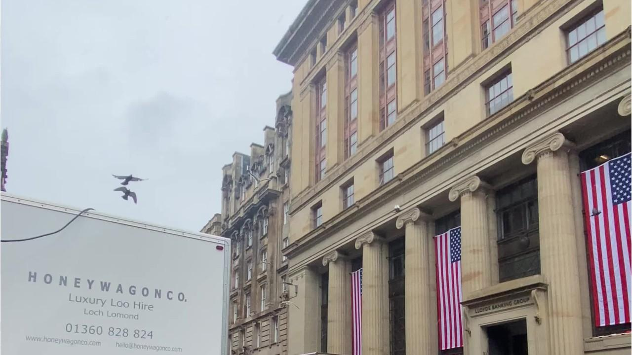Huge American flags mounted on Glasgow city centre buildings for Indiana Jones filming