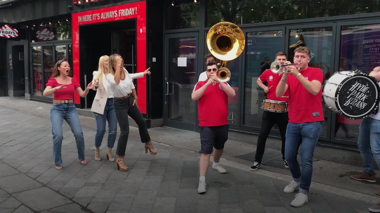 Atomic Kitten get into England semi-final spirit with brass band
