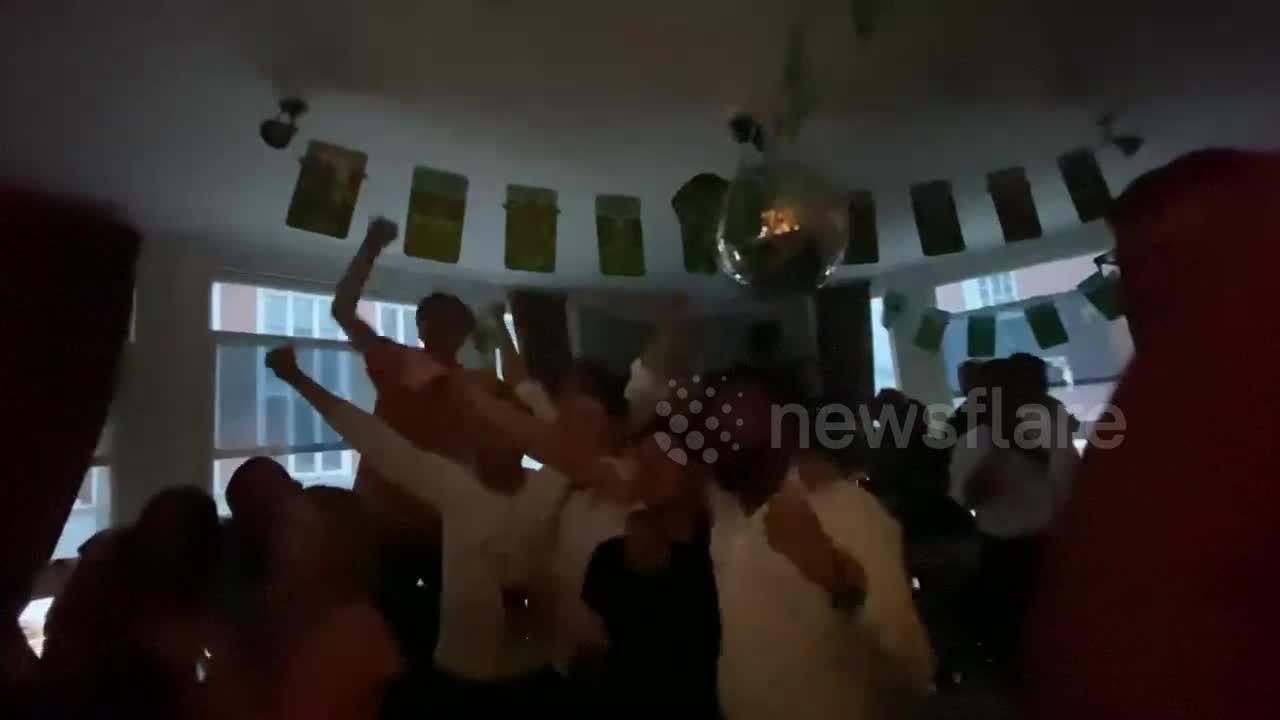 England fans go wild in London pub as their team equalises in semi-final match