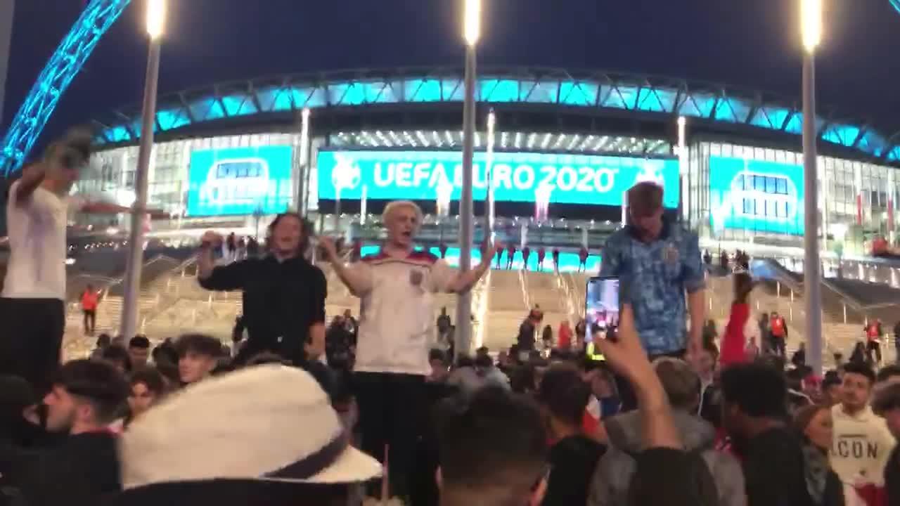 England fans outside Wembley Stadium celebrate winning goal by Harry Kane