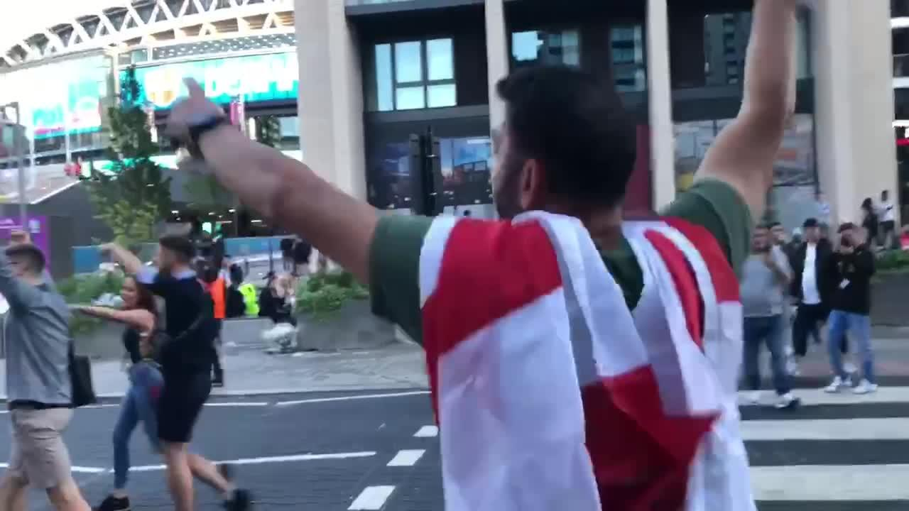 Fans celebrate outside Wembley after England draw level with Denmark own-goal