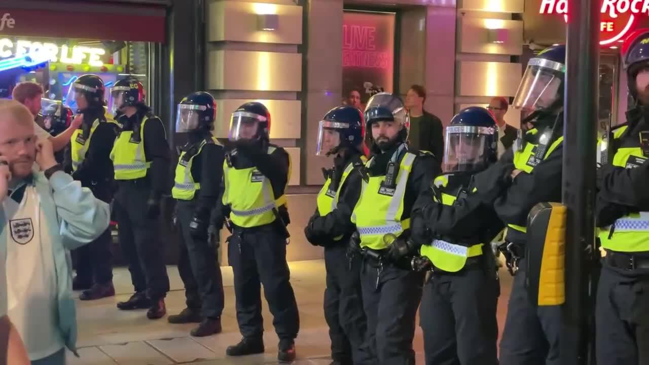 Riot police appear in central London, changing the mood of England fan celebration
