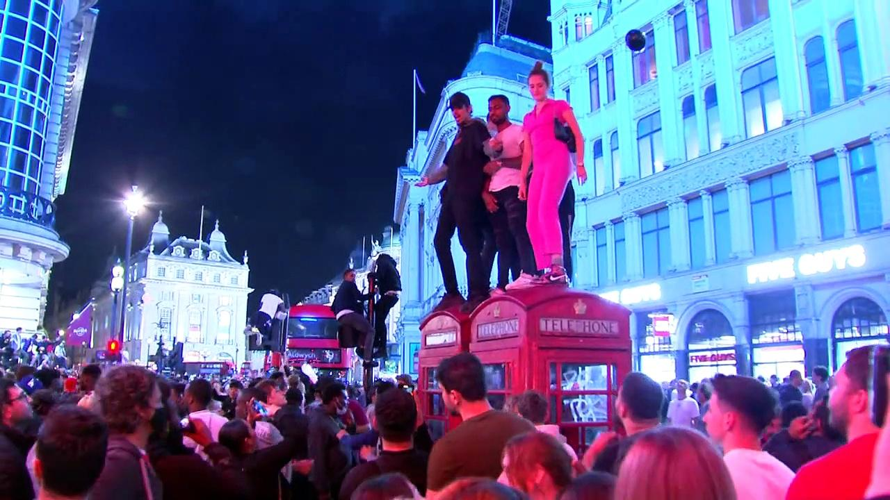 Police move in to disperse England fans in central London