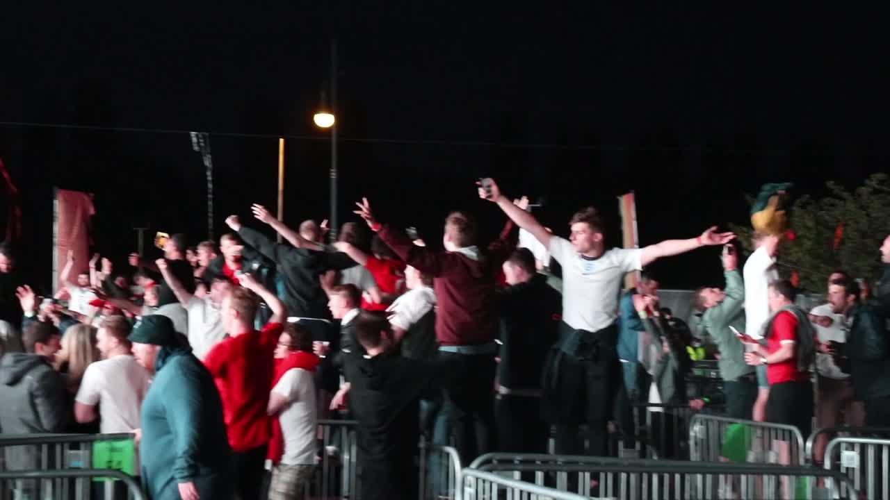 England supporters rush to front of fan park in Manchester following Euro 2020 win over Denmark