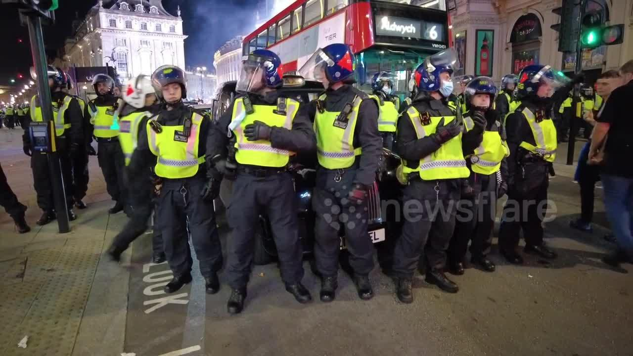 Riot police seal off Piccadilly Circus, attempt to move thousands of football fans following England's Euro 2020 win over Denmar