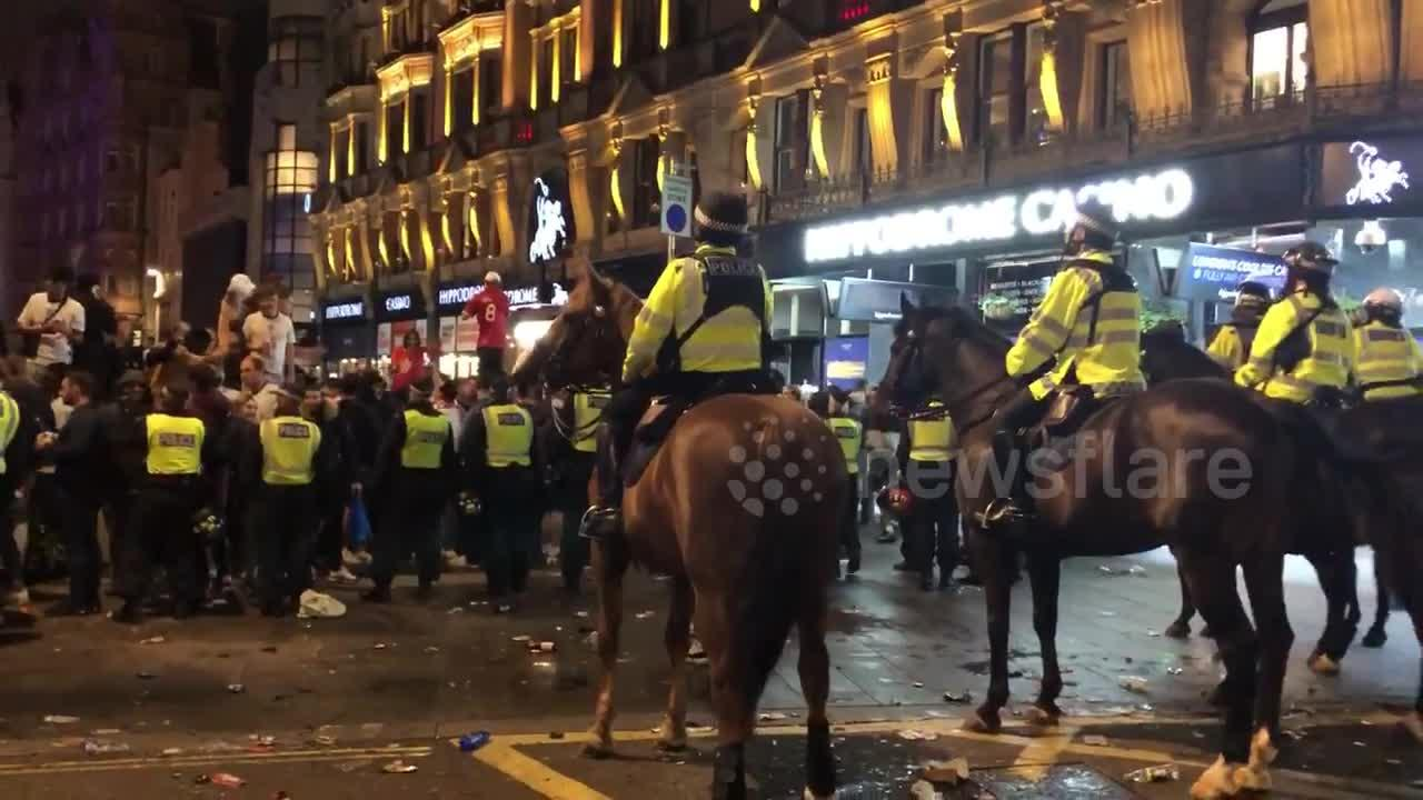 English fans throw bottles at police on horses after Euro 2020 win against Denmark