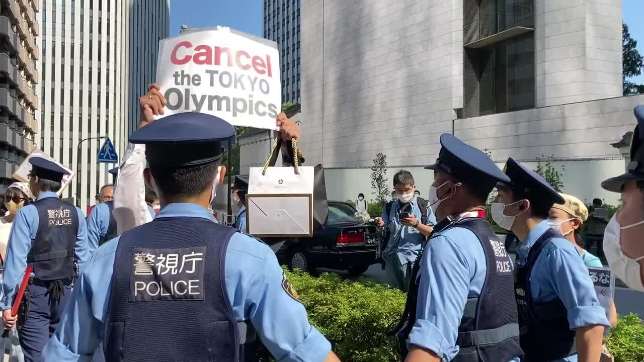 'No Olympics' protest outside Tokyo hotel of IOC President Thomas Bach