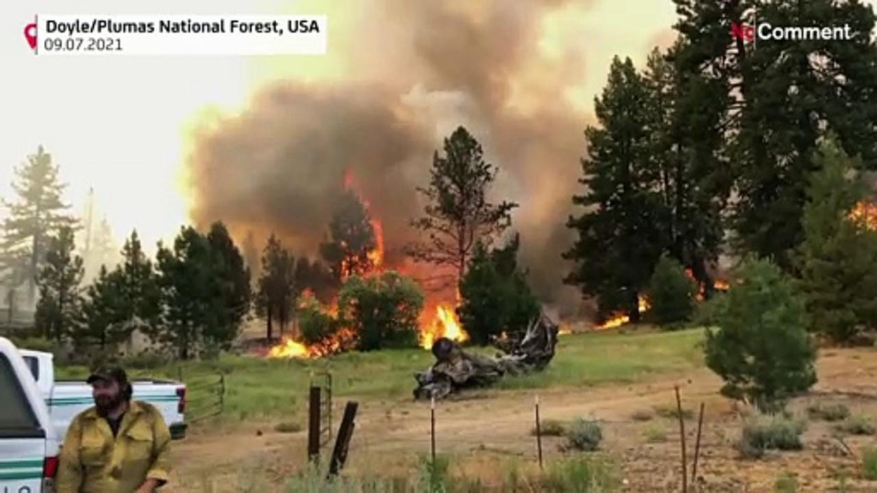 California fires advance as heat wave covers West