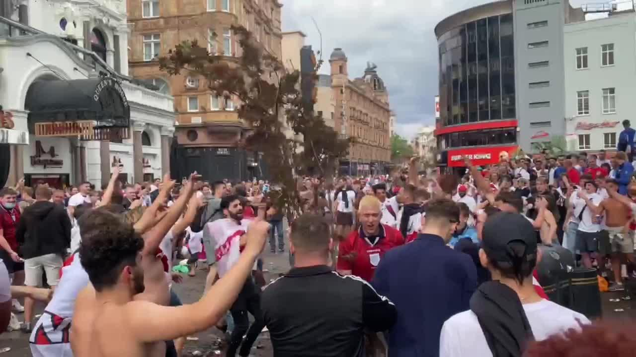 England fans hurl TREES at each other as police struggle to control London crowds
