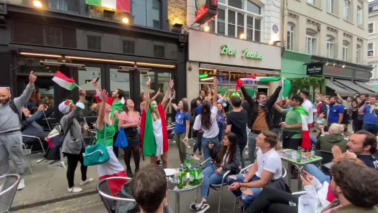 Excited Italians get ready for Euro 2020 final to tune of national anthem and 'Seven Nation Army' in Soho's Bar Italia