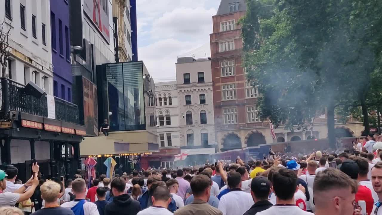 Thousands of England fans sing Oasis' 'Wonderwall' in London's Leicester Square