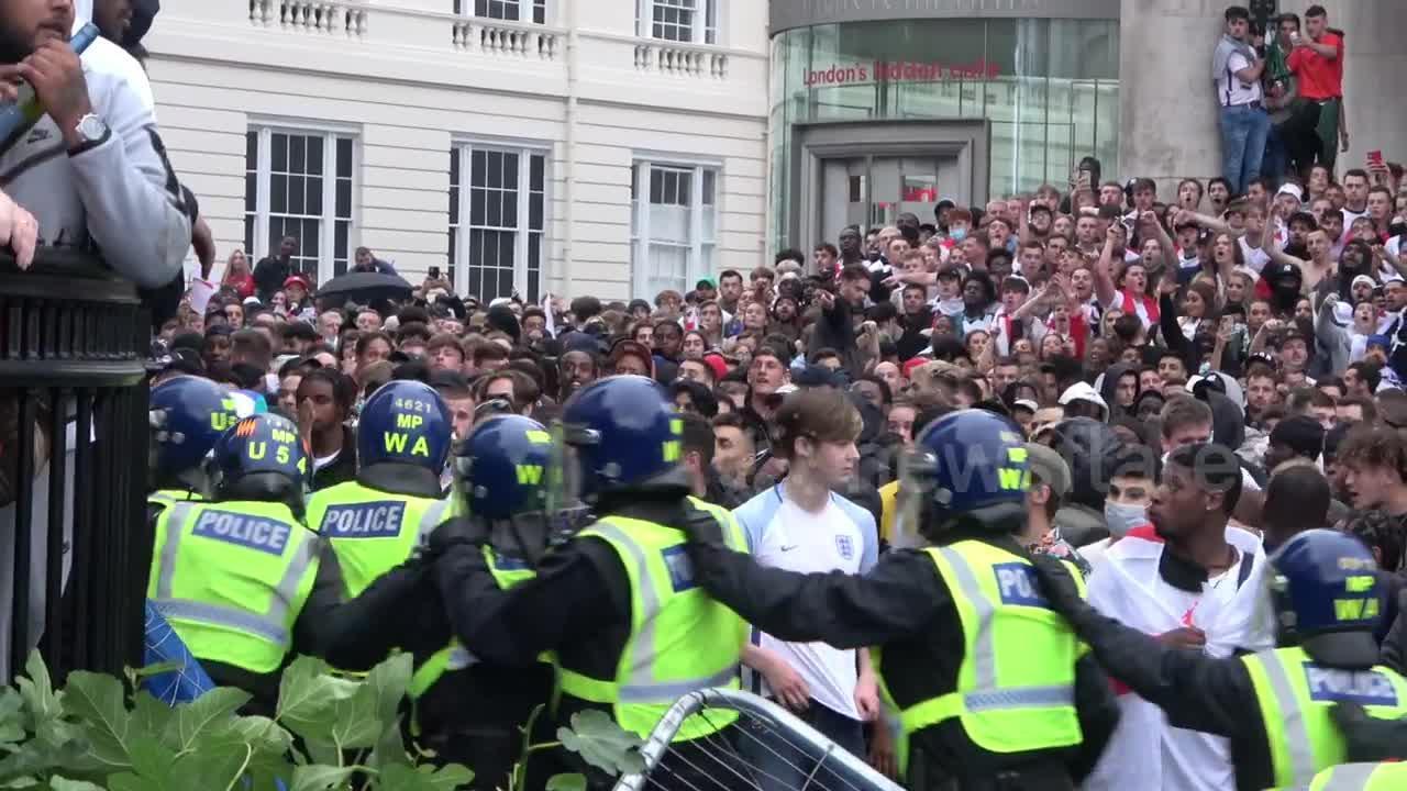 Violent scenes in Trafalgar Square as England fans break through police barricades during match