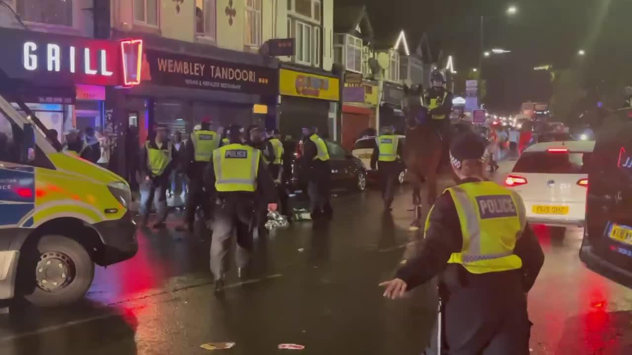 Moments of tension as England fan punches Italian supporter and runs away from police in Wembley, London