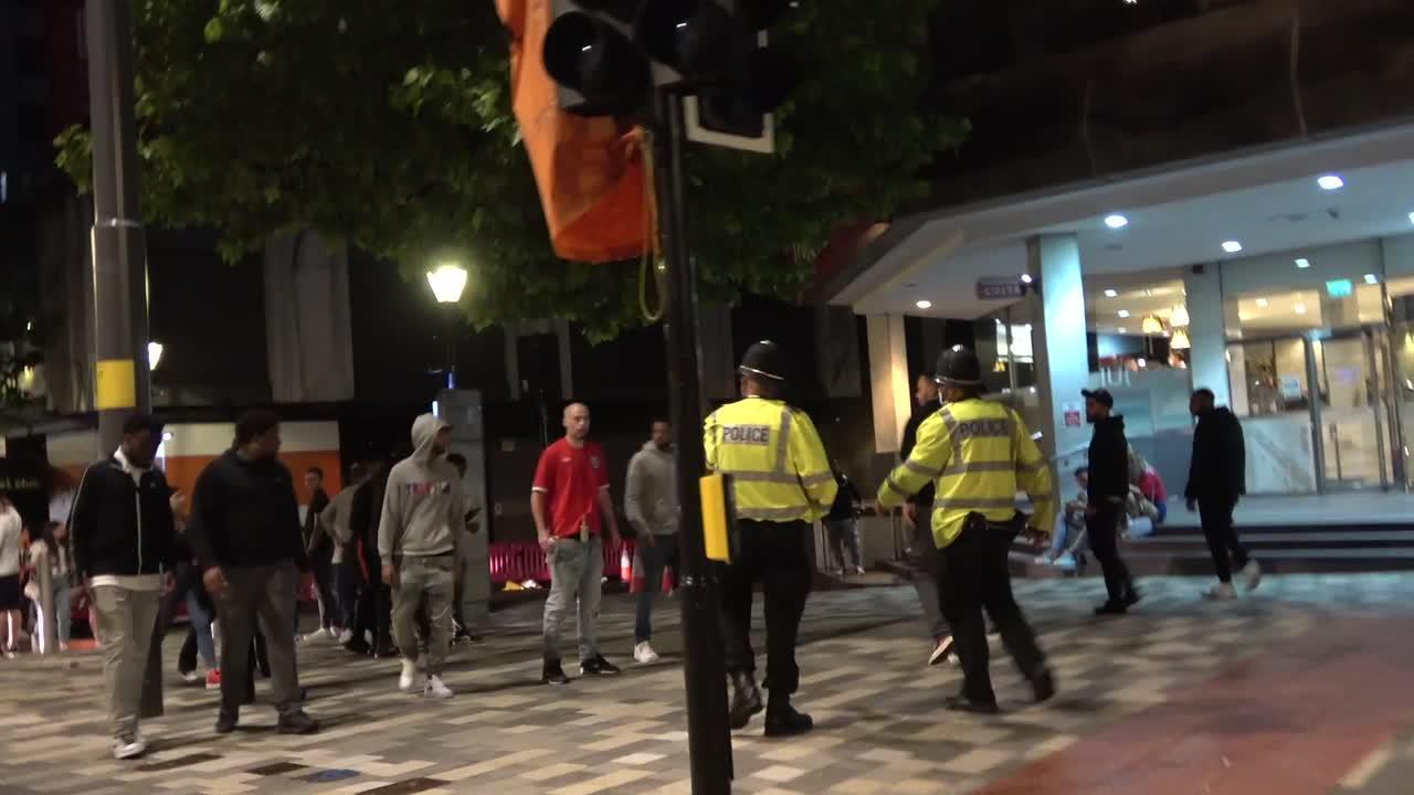 Cops threaten to spray England fan who armed himself with a vodka bottle in Birmingham after Euro 2020 final