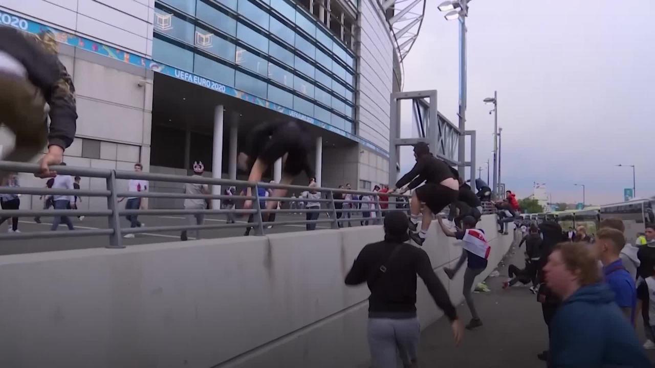 Ticketless fans jump Wembley perimeter to watch Euro 2020 final