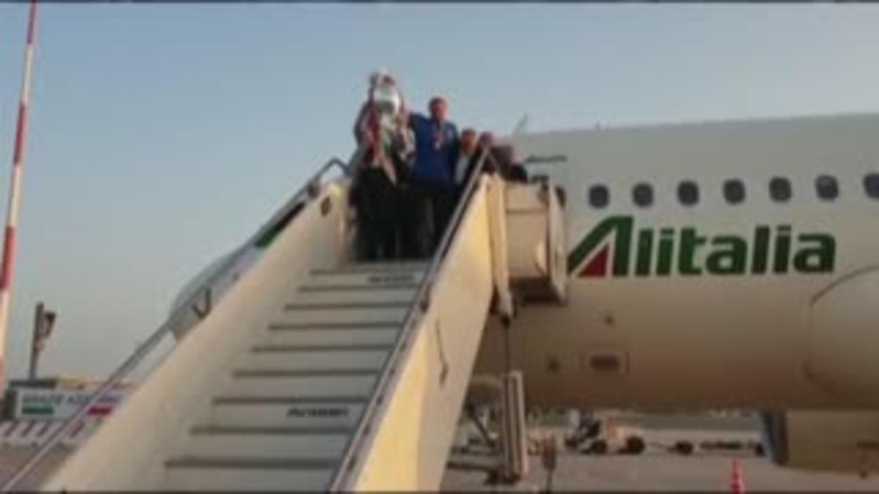 Italy arrive back to jubilant scenes in Rome