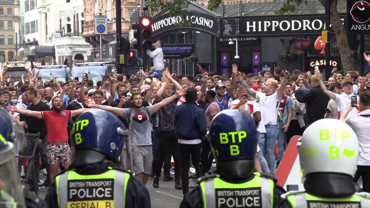 Watch England fans clash with police outside Wembley