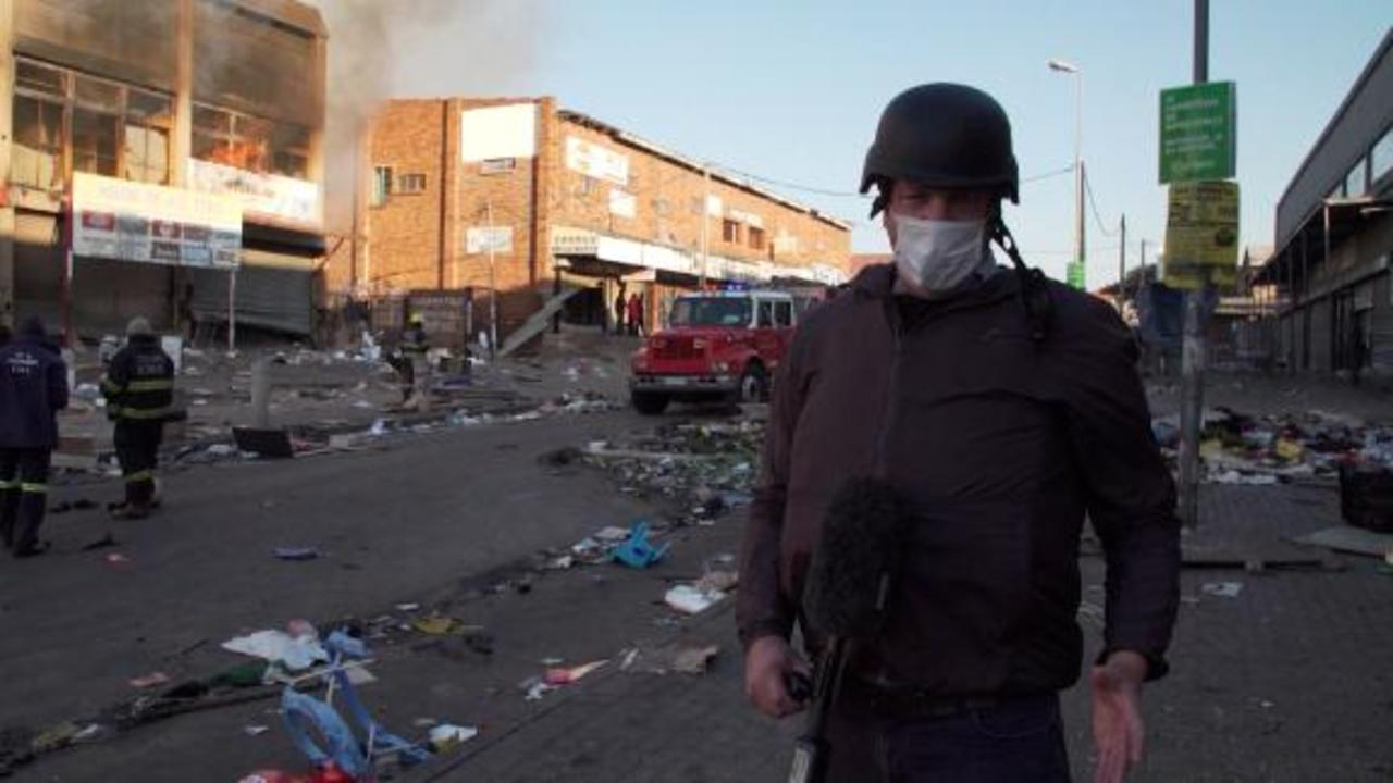 Protests turn to looting after former president is jailed