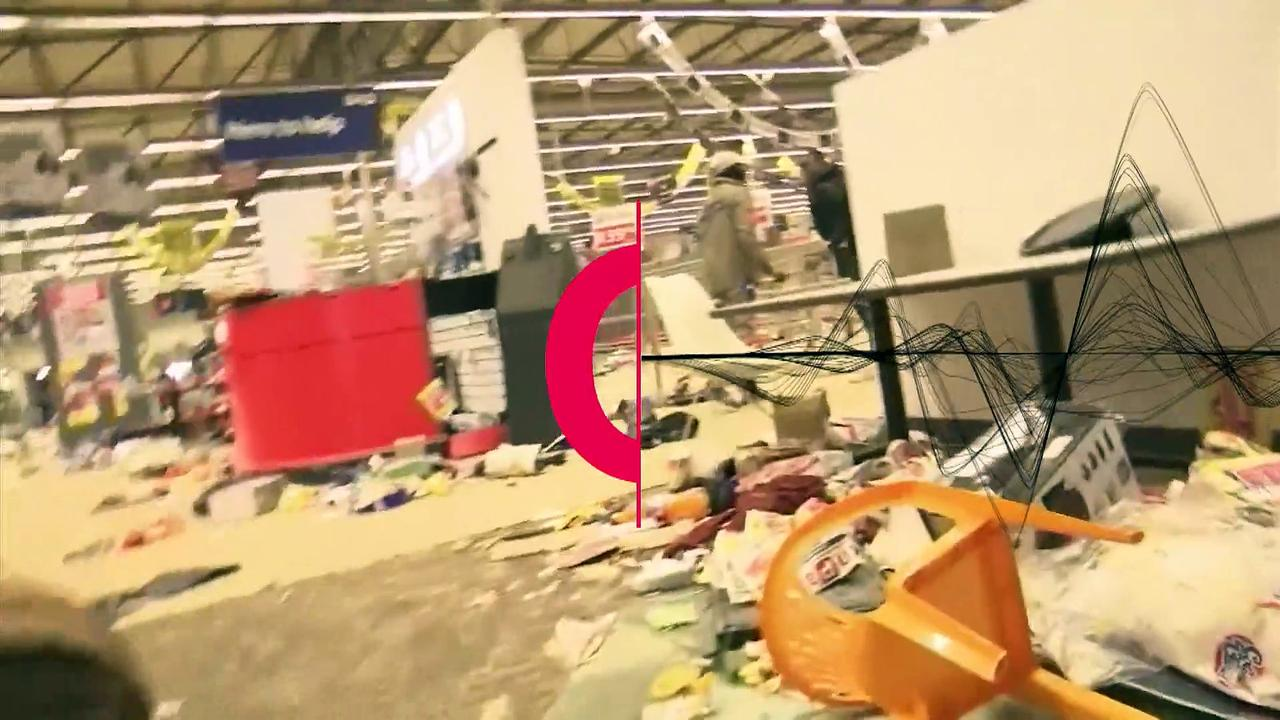 Tense scenes in ransacked South Africa supermarket
