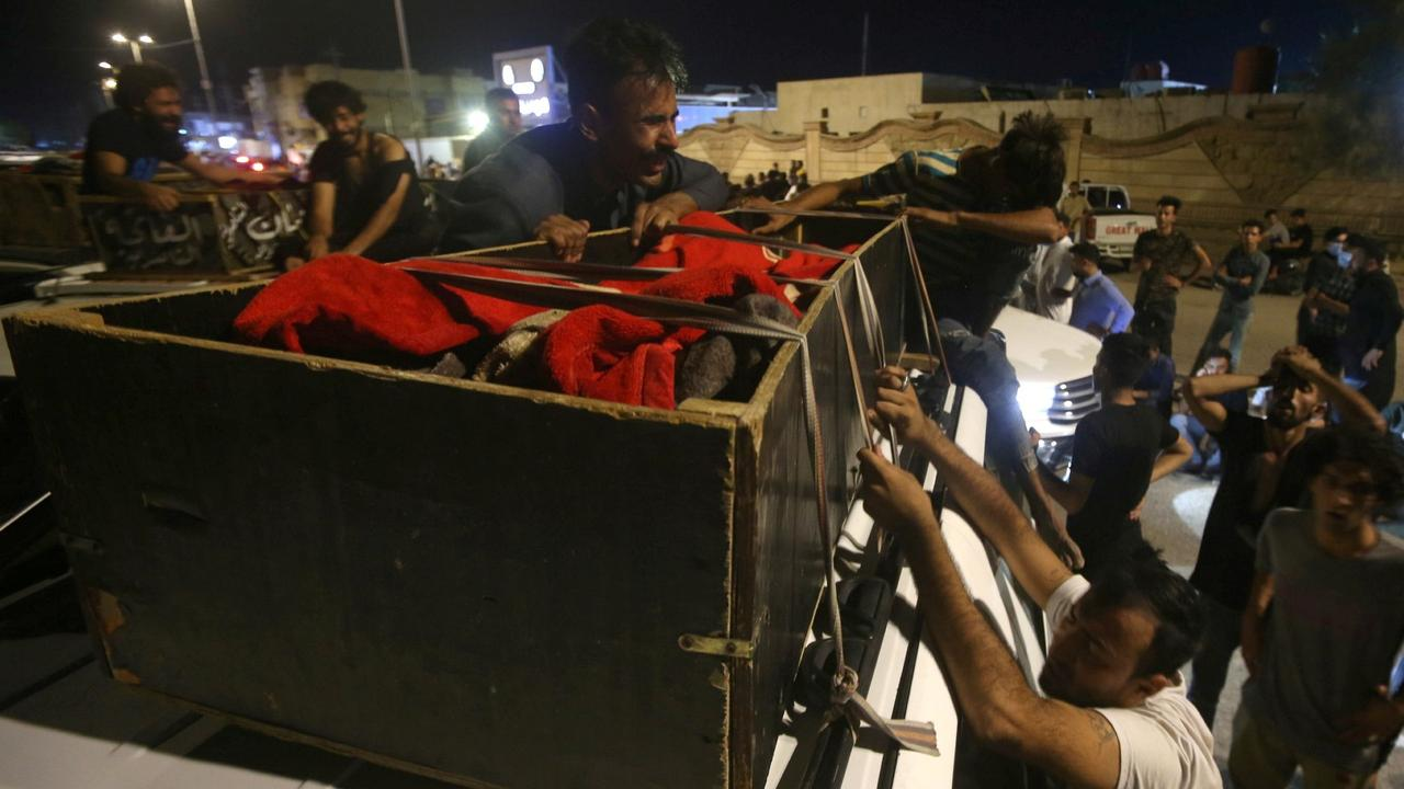 Dozens dead as fire rips through Iraq COVID ward