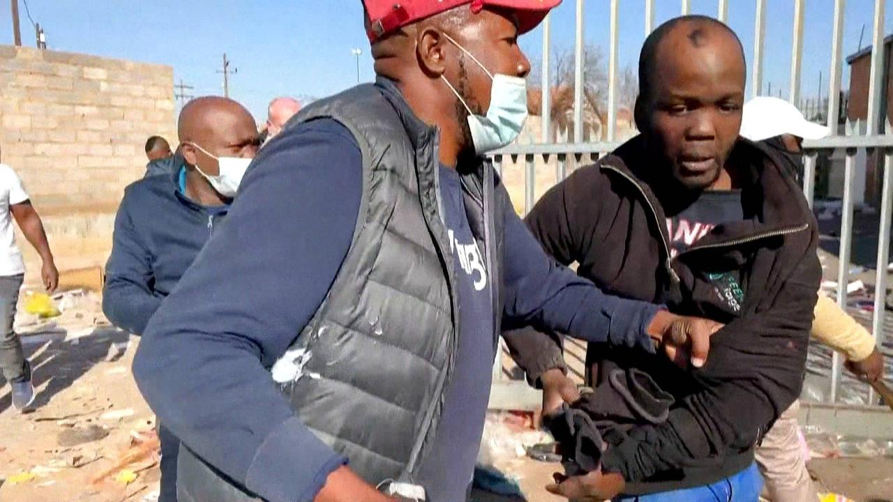 South Africa vigilantes step in as rioters overwhelm police