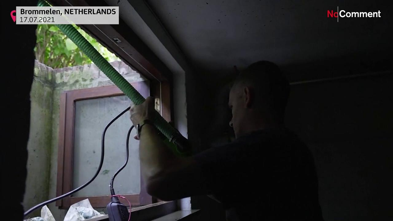 Dutch residents assess flood damage to homes