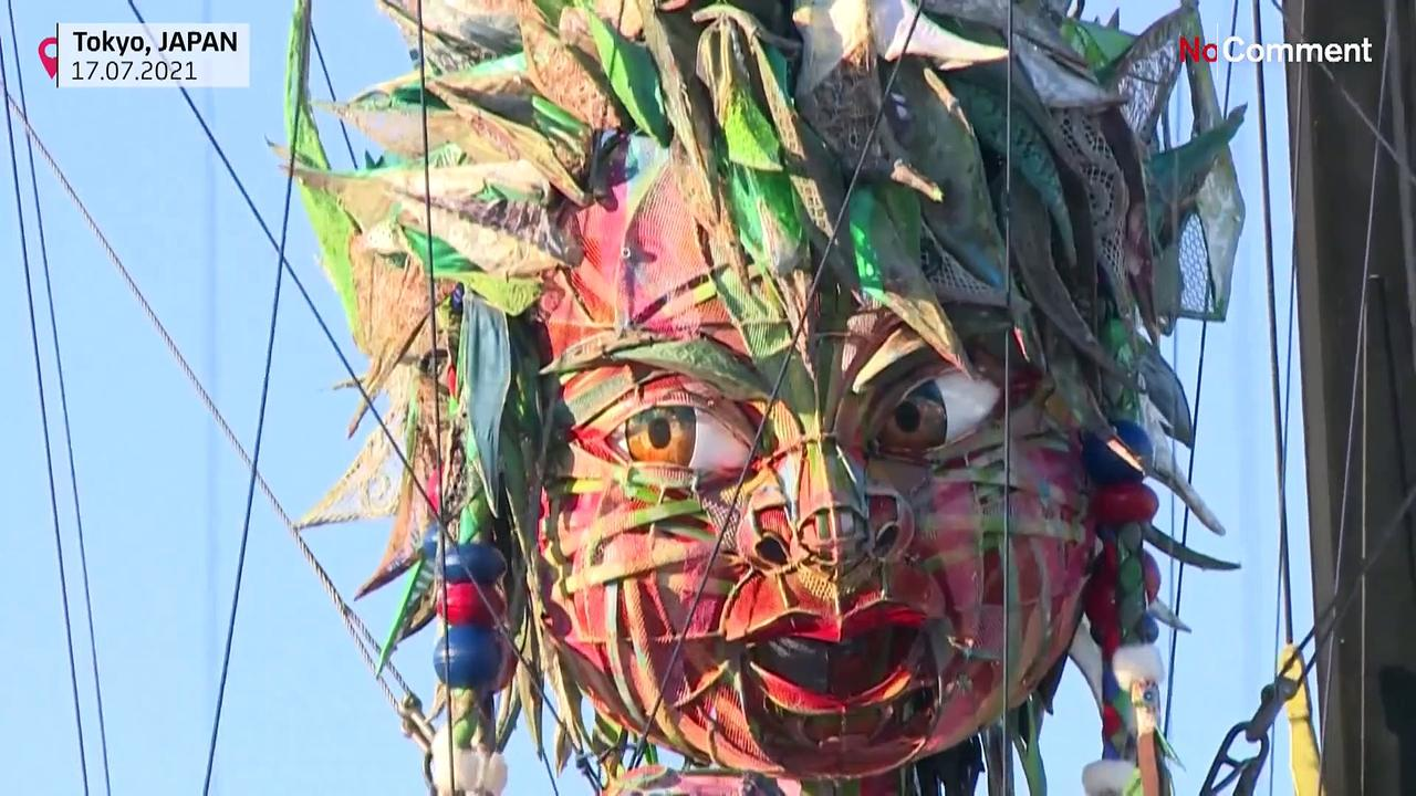 Giant puppet from Japan tsunami-hit region stages show ahead of Olympics
