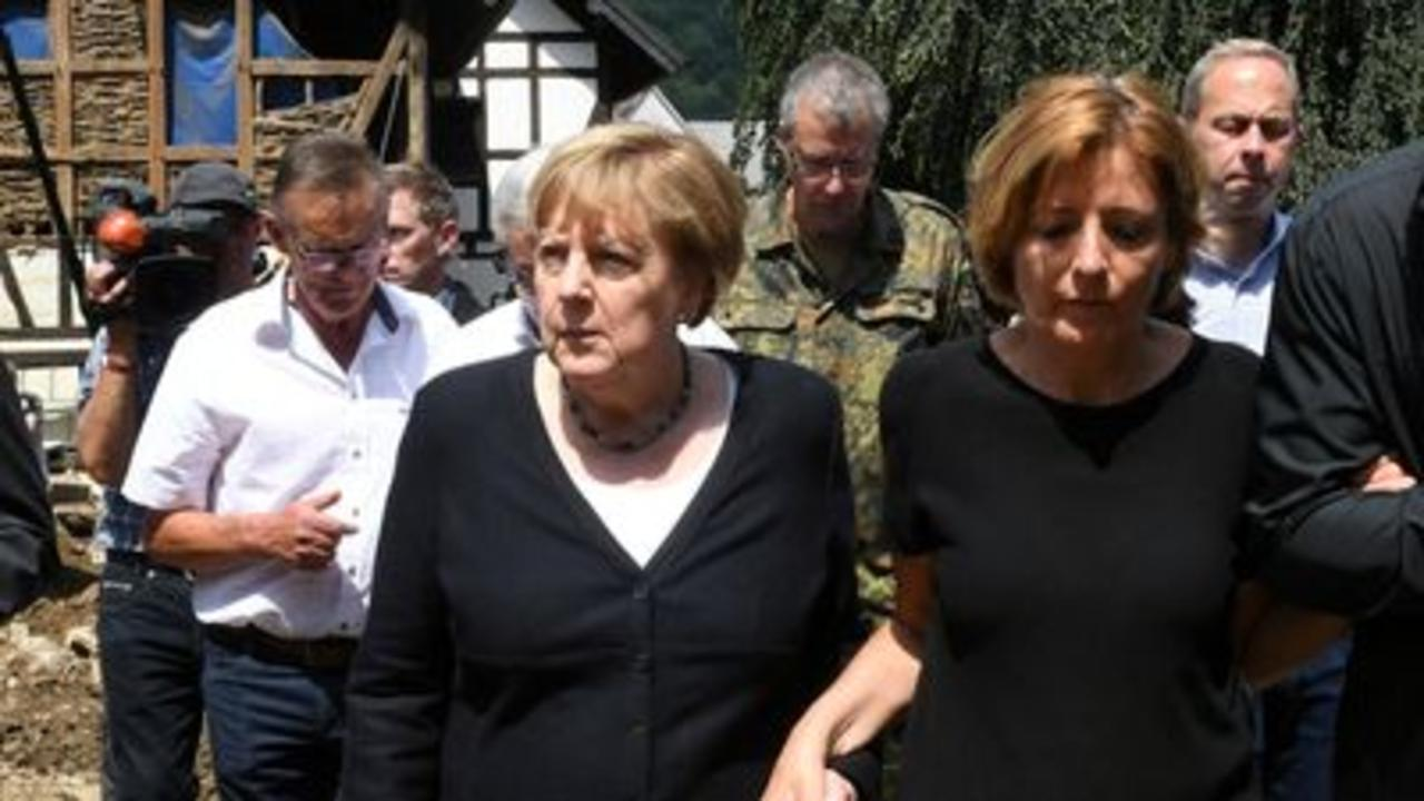 Merkel surveys floods damage and meets survivors