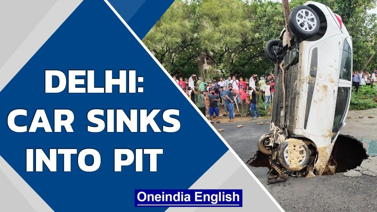 Delhi: Car sinks into pit that appeared after heavy rains in Dwarka   Oneindia News
