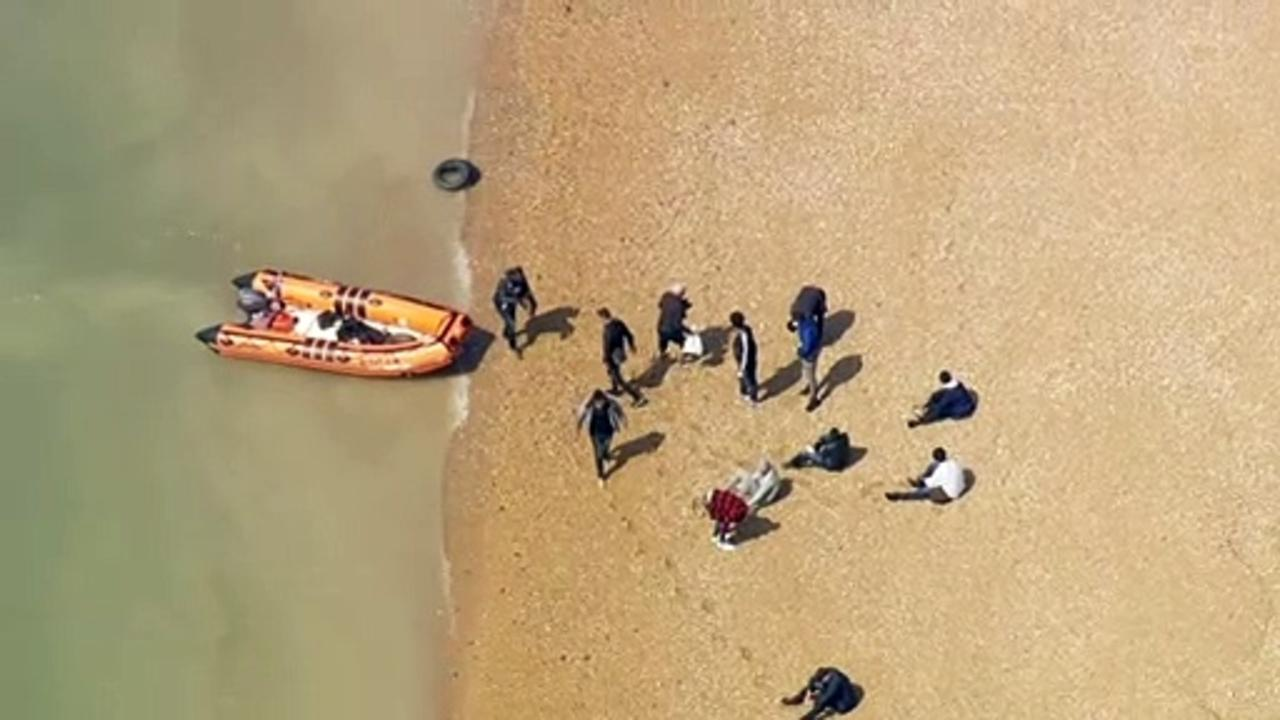 Migrants land on Kent beach after crossing the Channel