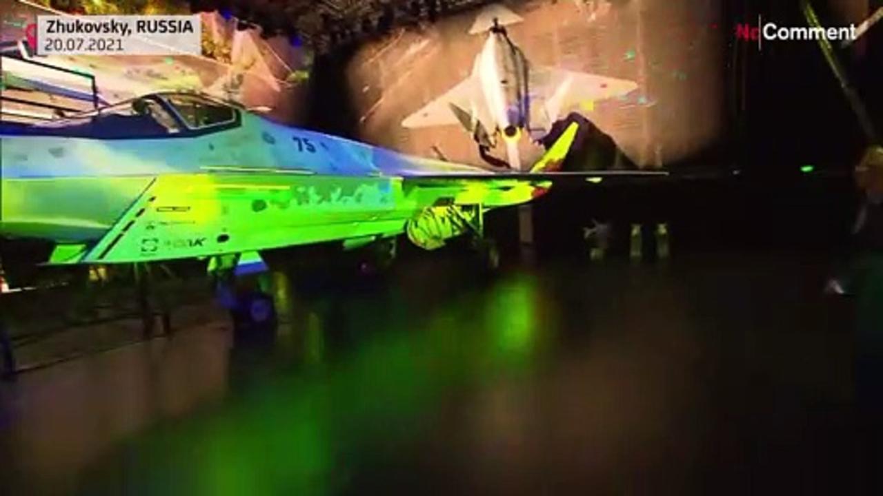 Russia unveils new war plane, Putin hails air power