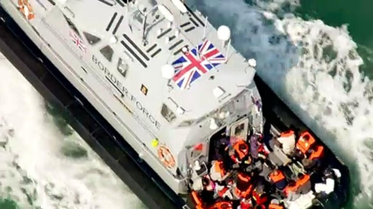 Migrants brought ashore in Dover by UK Border Force