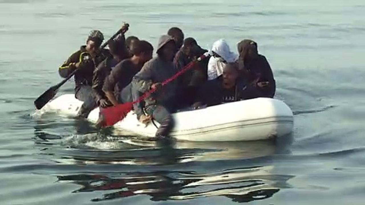 Group of men in small dinghy make journey from France