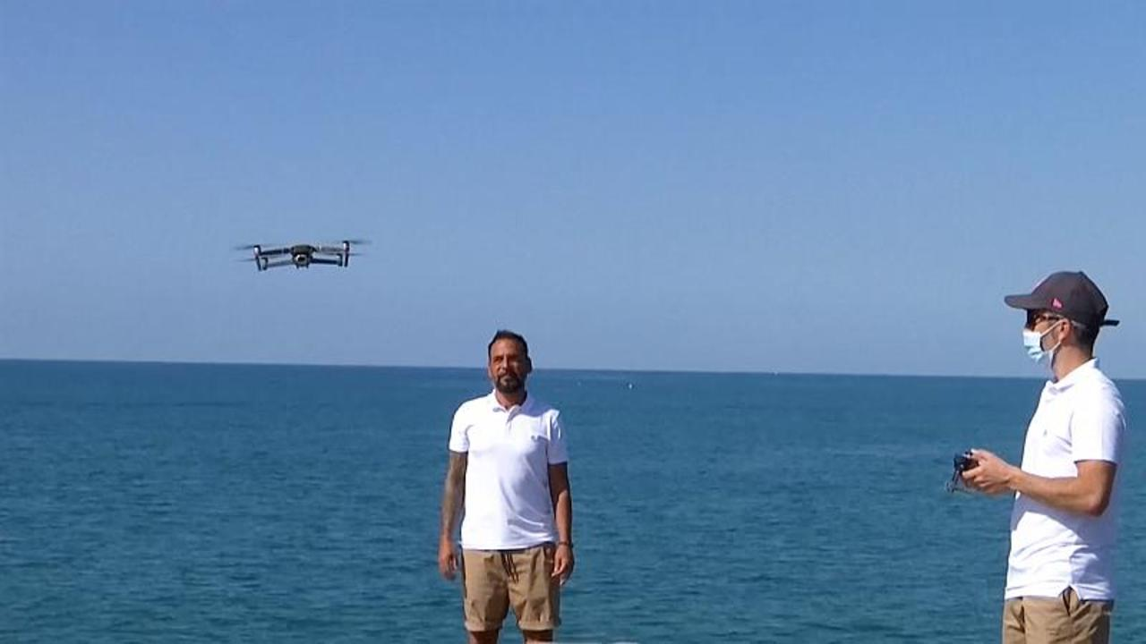 Drones flying over Catalonia's beaches to enforce social distancing as COVID rates soar