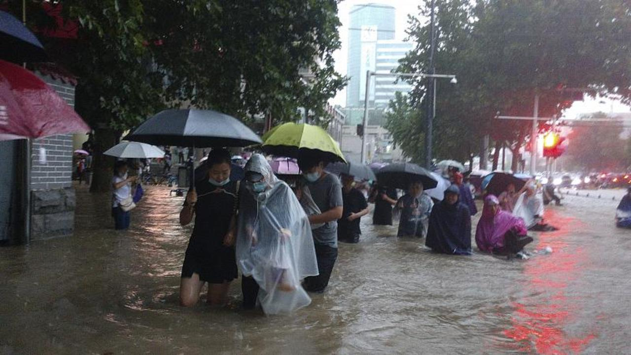 Flooding in central China turns streets to rivers, kills at least 25