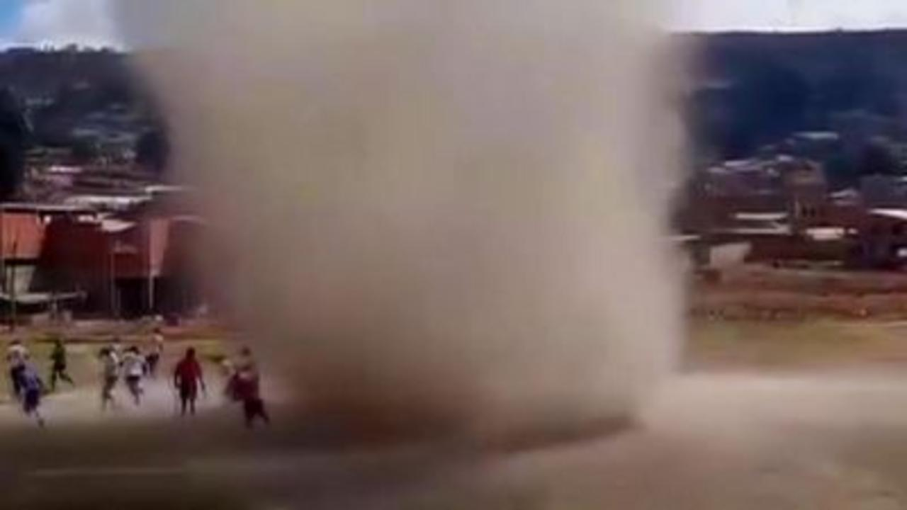 Dust devil whirlwind disrupts football match