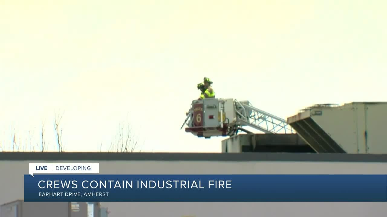 Fire crews continue to battle warehouse fire in Amherst