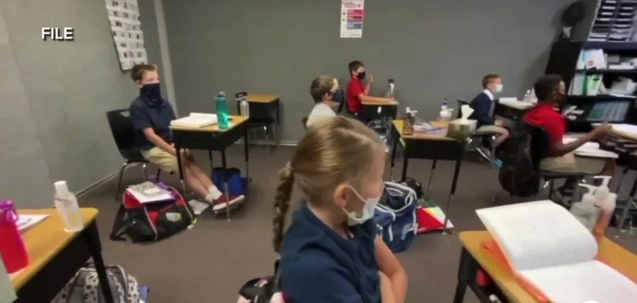 Pediatricians' group says all kids should wear masks in school, but some states block such mandates