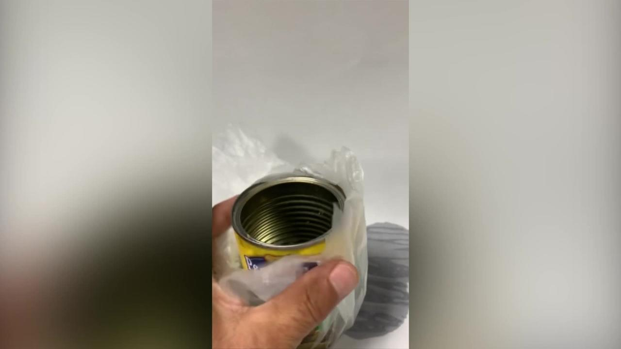 US man claims he found half a DEAD RAT inside a can of peanuts