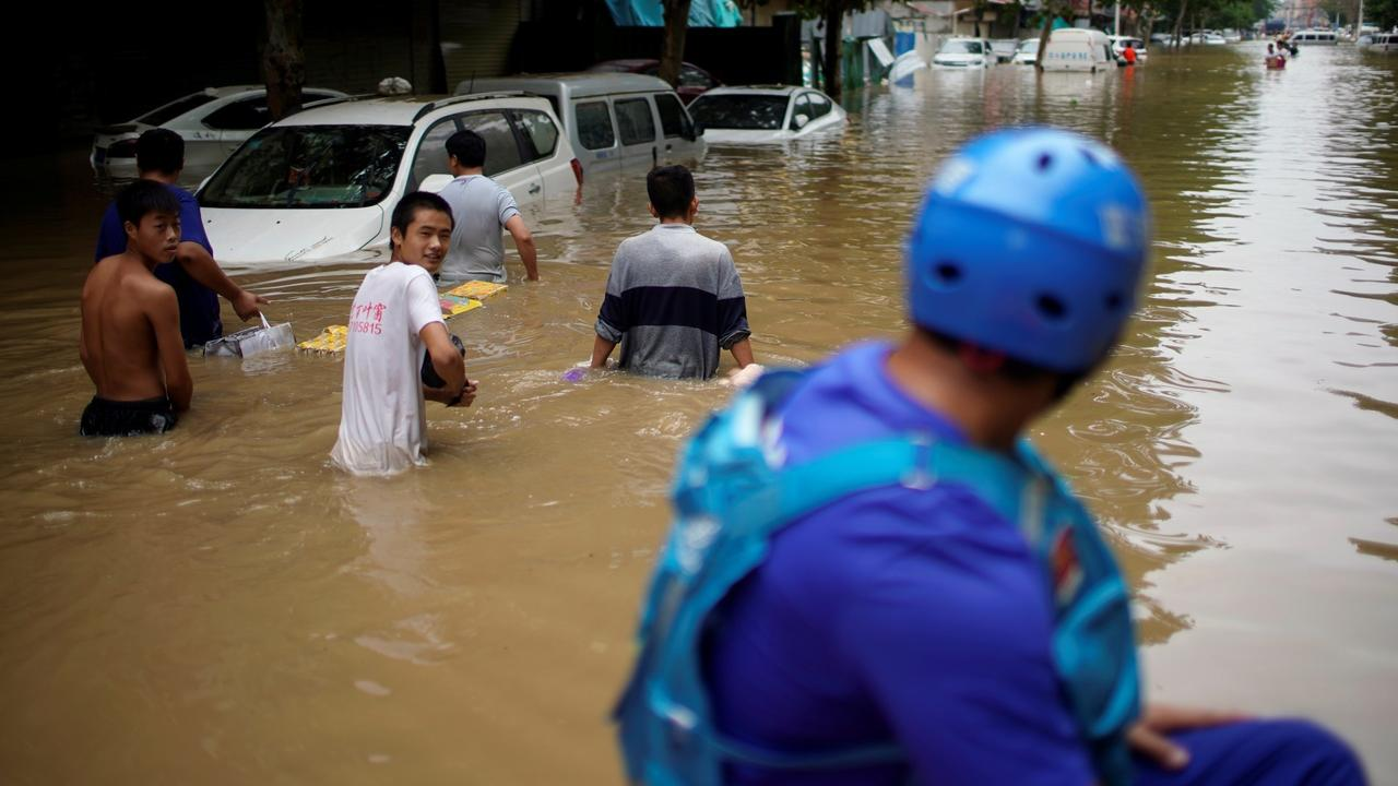 Flood toll rises in central China, as tens of thousands evacuated