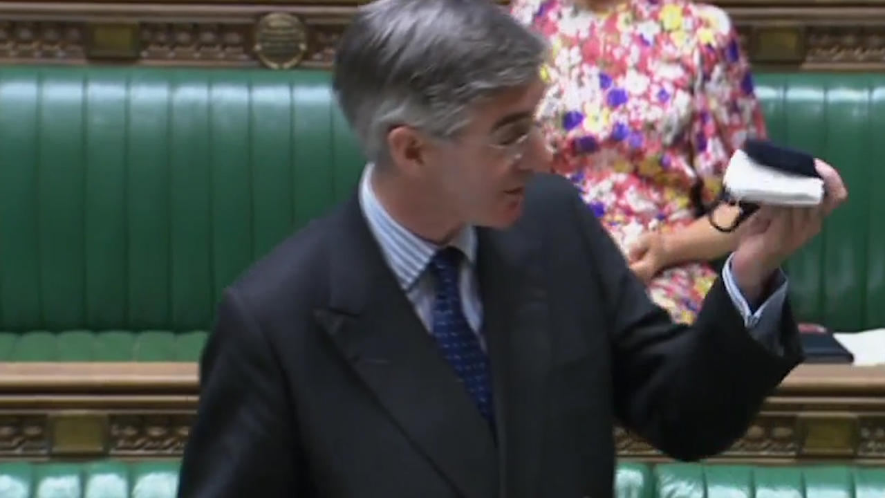 Jacob Rees-Mogg waves face mask in the air but refuses to wear it