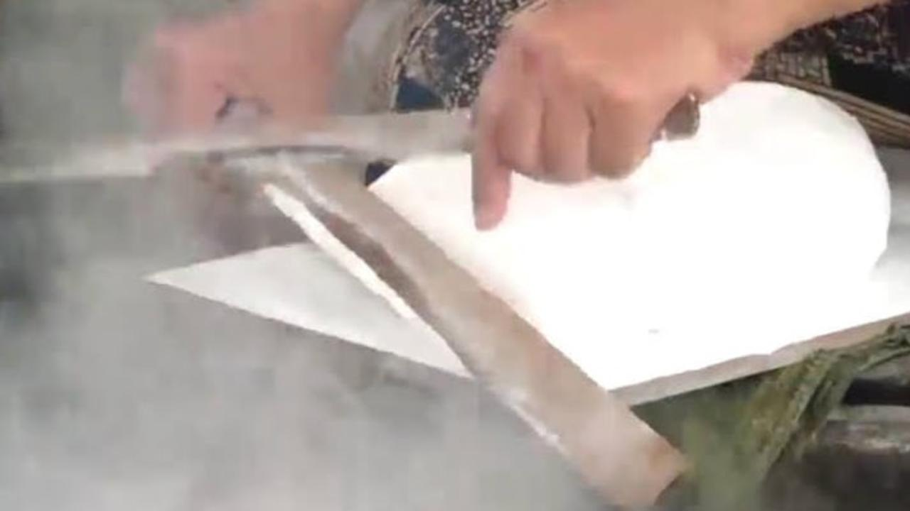 This baker uses bamboo to slice dough, and it's so satisfying
