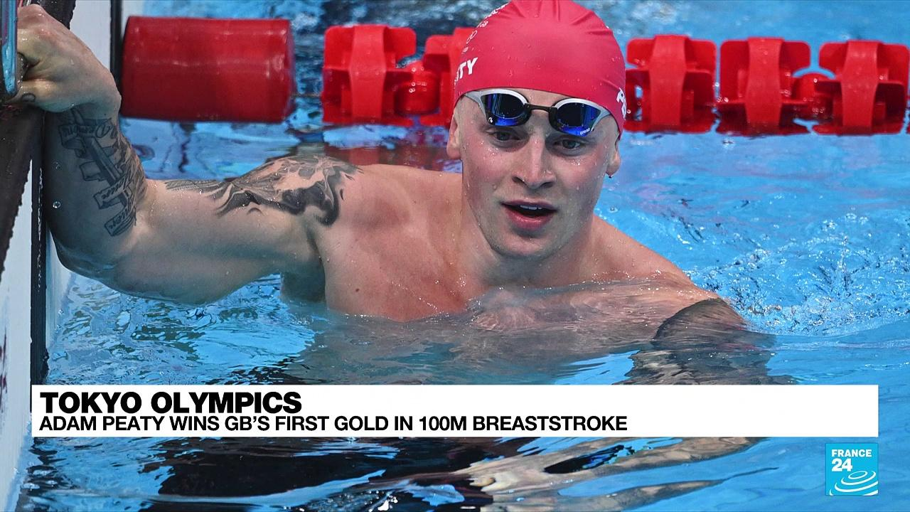 Britain's Adam Peaty wins 100m breaststroke gold to defend Olympic title