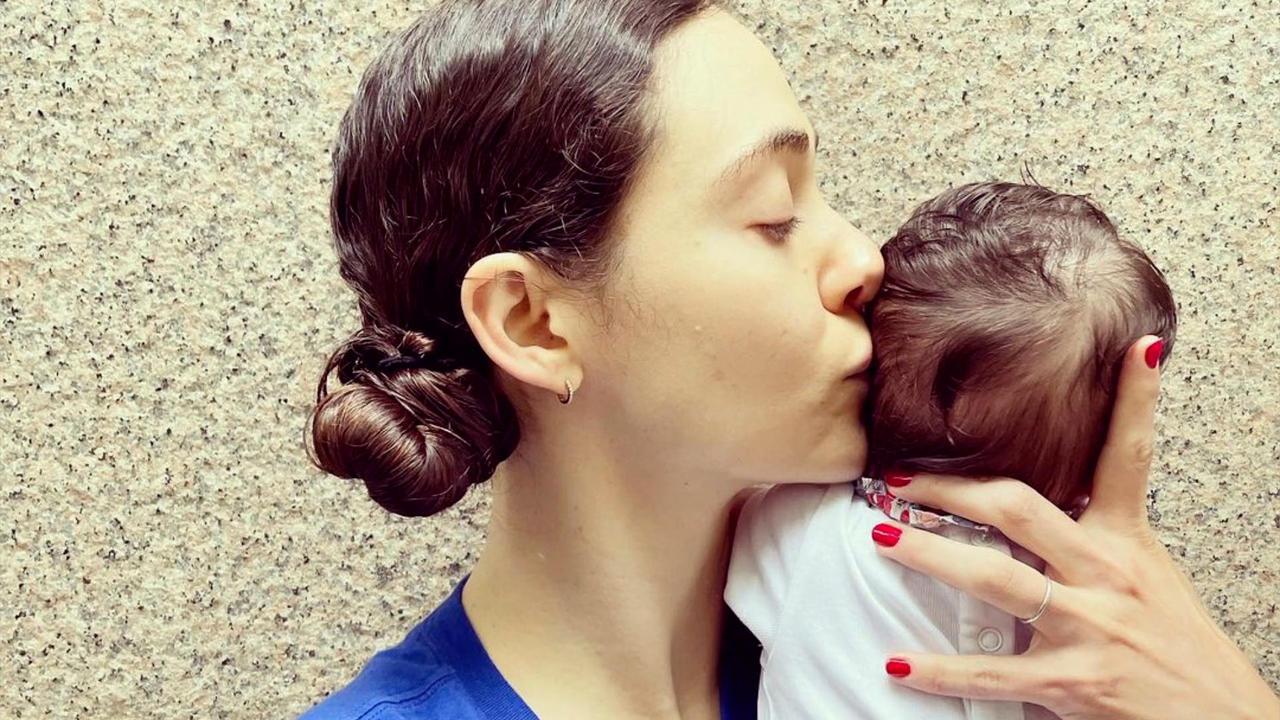 Emmy Rossum encourages vaccination in first photo of newborn daughter