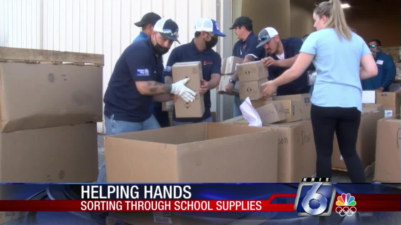 Volunteers with Chemours help sort school supplies gathered for Operation SOS