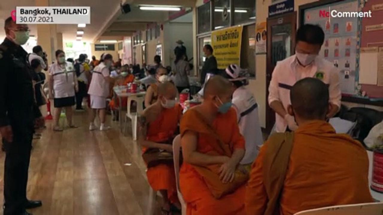 Buddhist monks receive AstraZeneca vaccine in Thailand
