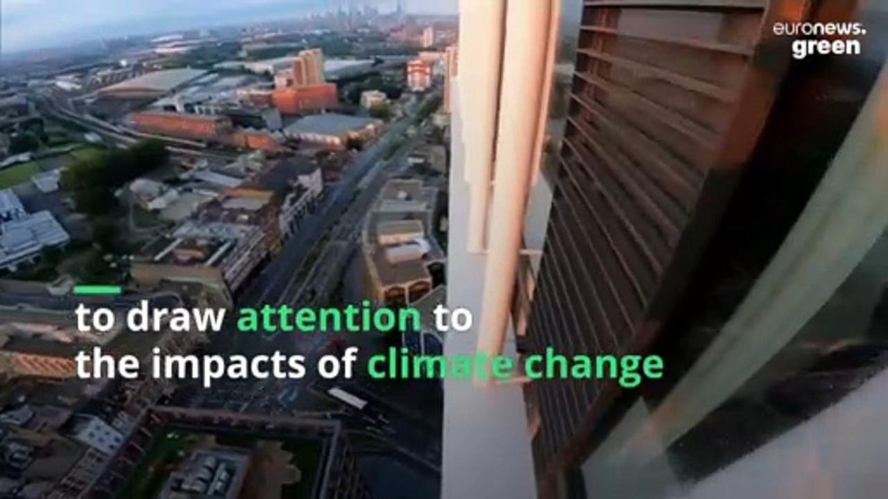 Free-climber scales London skyscraper to raise awareness of climate change