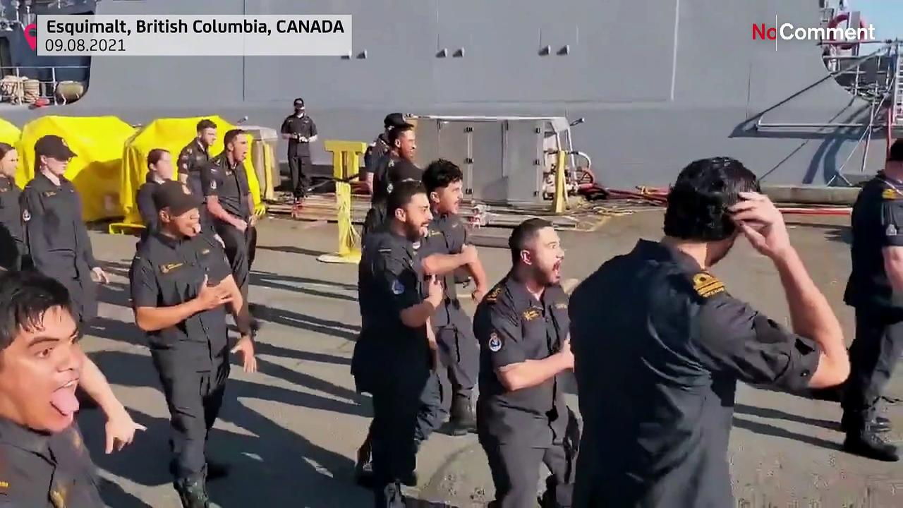 New Zealand navy personnel welcome colleagues aboard warship with powerful haka